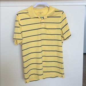 Yellow collared shirt with navy stripes.